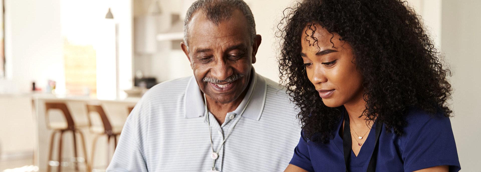 happy senior man with his caregiver