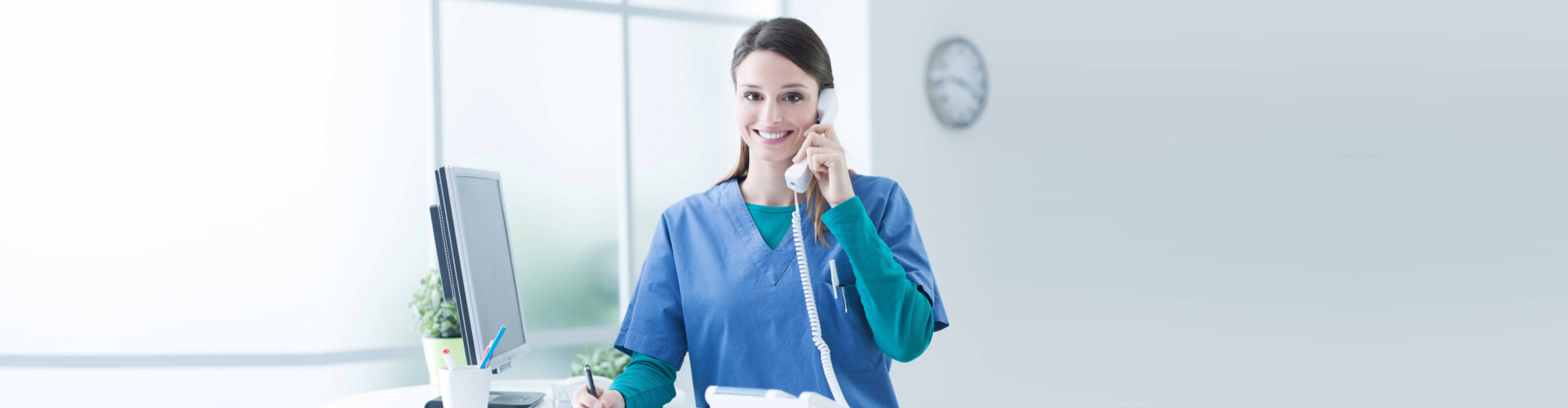 caregiver answering a telephone call